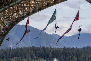 Last summer Greenpeace activists opposed to the Trans Mountain pipeline expansion hung from Vancouver's Iron Workers Memorial Bridge to form an 'aerial blockade' to prevent two oil tankers from leaving the Westridge Marine Terminal.